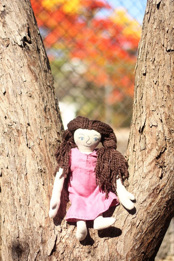dolls by trees